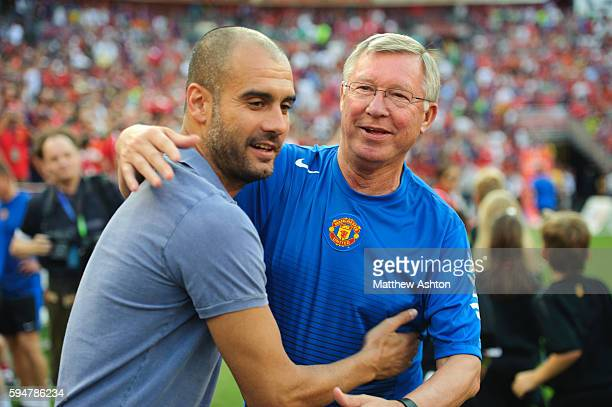Josep Guardiola the head coach / manager of FC Barcelona talks to Sir Alex Fersuson the head coach / manager of Manchester United