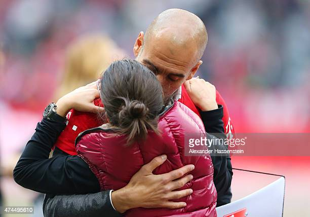 Josep Guardiola the head coach of Bayern Muenchen and his daughter Maria celebrate after winning the league during the Bundesliga match between FC...