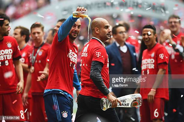 Josep Guardiola the head coach of Bayern Muenchen and Pepe Reina of Bayern Muenchen celebrate after winning the league during the Bundesliga match...