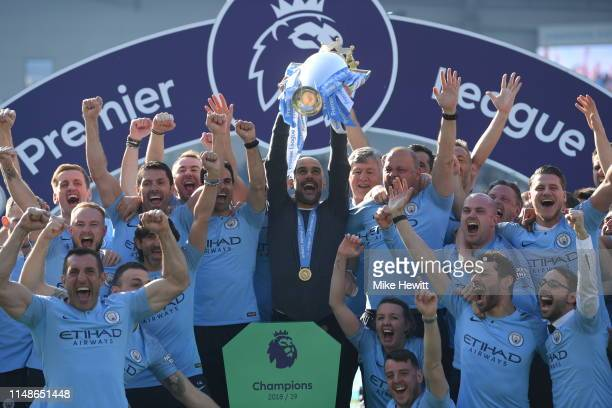 Josep Guardiola,Manager of Manchester City lifts the Premier League Trophy after winning the title during the Premier League match between Brighton &...