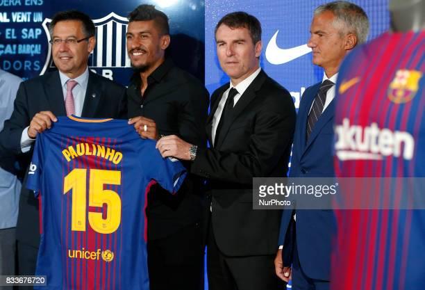 Josep Maria Bartomeu president of FC Barcelona and Robert Fernandez during the presentation of Paulinho as new player of FC Barcelona in Barcelona on...