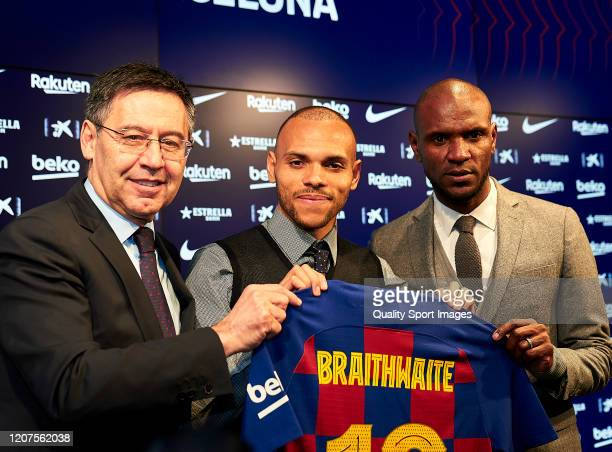 Josep Maria Bartomeu, president of FC Barcelona, Martin Braithwaite and Eric Abidal pose with a jersey for the media during Martin Braithwaite...