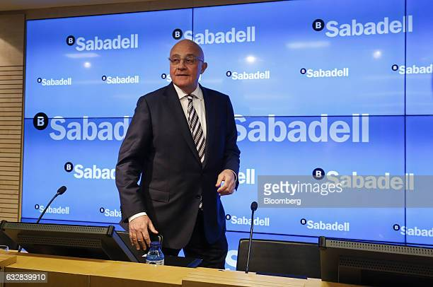 Josep Oliu, chairman of Banco de Sabadell SA, arrives for a news conference to announce company earnings in Barcelona, Spain, on Friday, Jan. 27,...