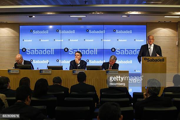 Josep Oliu, chairman of Banco de Sabadell SA, right, speaks during a news conference to announce company earnings in Barcelona, Spain, on Friday,...