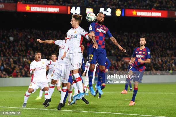 Josep Sene of RCD Mallorca challenges for the ball with Arturo Vidal of FC Barcelona during the Liga match between FC Barcelona and RCD Mallorca at...