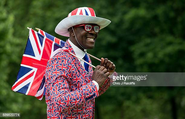 Joseph Afrane arrives in Union Jack clothing as members of the public gather in Green Park for a picnic and to watch The Queen's Patronage on a big...