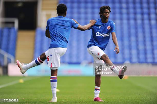Joseph Ajose and Nelson Abbey of Reading FC warm up prior to the Carabao Cup Second Round match between Reading and Luton Town at Madejski Stadium on...