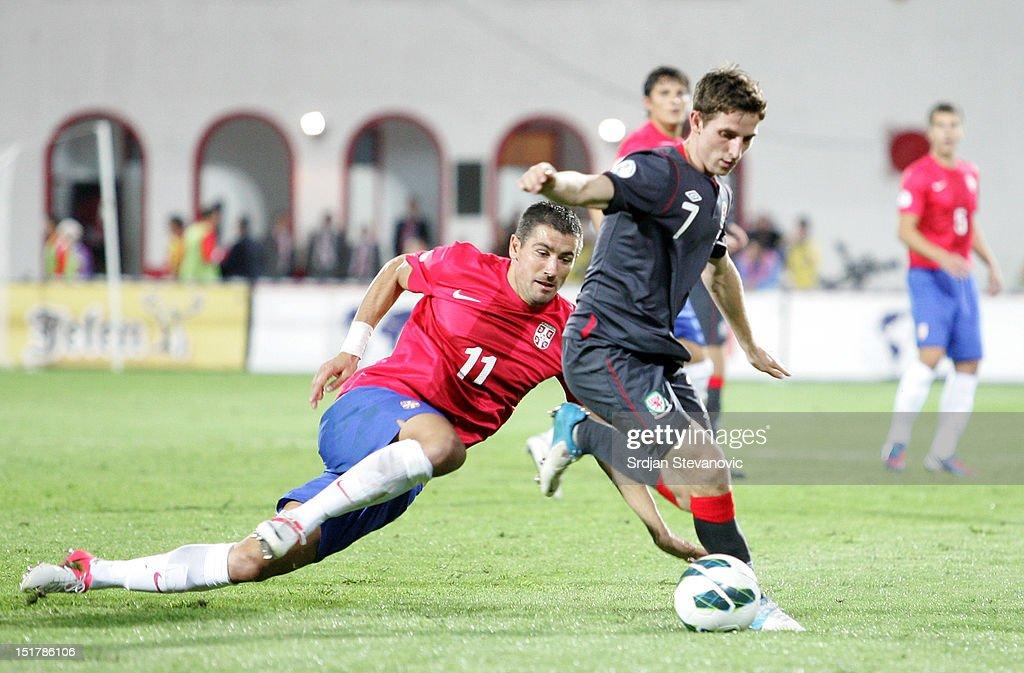 Joseph Allen (R) of Wales in action against Aleksandar Kolarov (L) of Serbia during the FIFA 2014 World Cup Qualifier at stadium Karadjordje Park between Serbia and Wales on September 11, 2012 in Novi Sad, Serbia