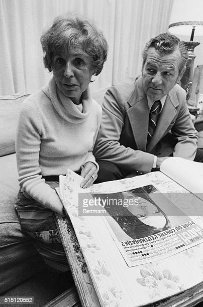 Joseph and Julia Quinlan examine the cover of the French magazine ParisMatch that is part of their scrapbook on their daughter Karen Ann Quinlan...