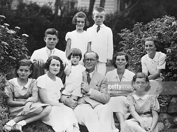 Joseph and Rose Kennedy pose with eight of their children.