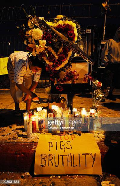 Joseph Arias lights candles at a makeshift memorial to Manuel Jamines on September 8 2010 in Los Angeles California Protesters have continued to...