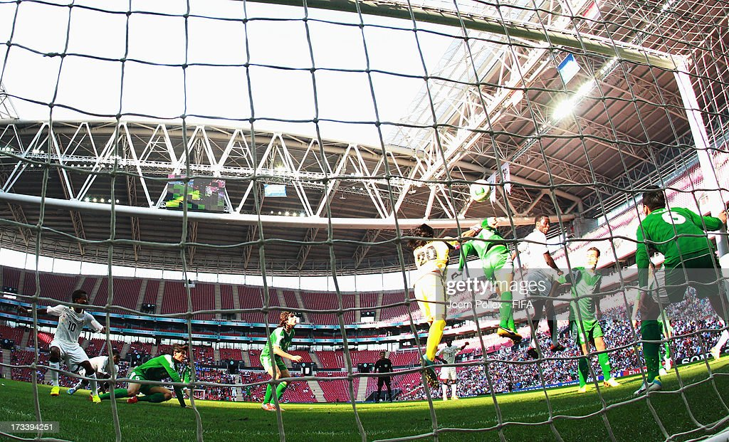 Joseph Attamah (3rd R) of Ghana scores his team first goal during the FIFA U-20 World Cup 3rd Place playoff match between Ghana and Iraq at Ali Sami Yen Arena on July 13, 2013 in Istanbul, Turkey.