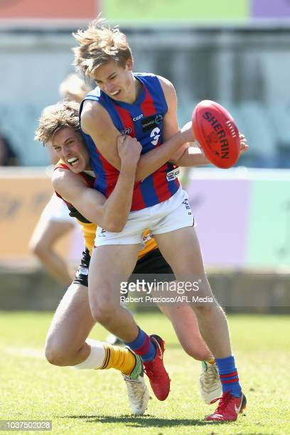 Joseph AytonDelaney of Oakleigh is tackled during the 2018 TAC Cup Grand Final match between Dandenong and Oakleigh at Ikon Park on September 22 2018...