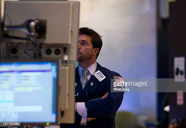 Joseph B Dreyer of Knight Capital Americas LP works before the US Federal Reserve Federal Open Market Committee rate decision on the floor of the New...