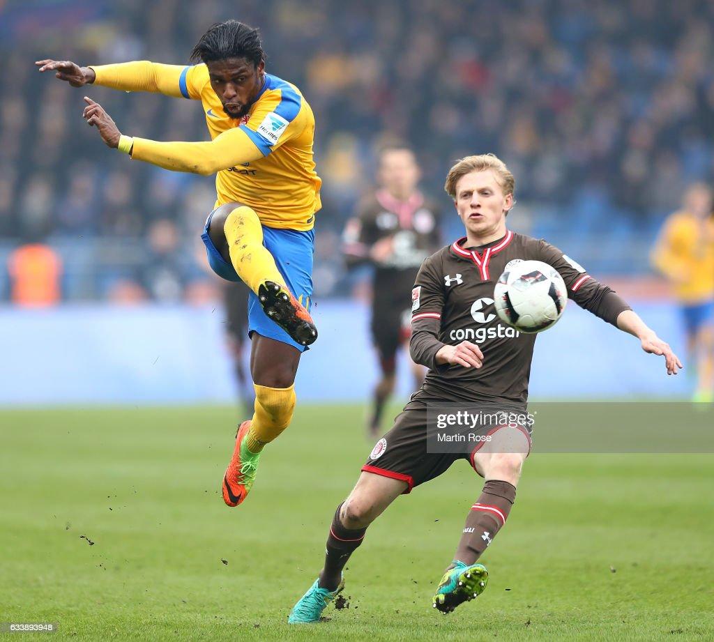 Joseph Baffo of Braunschweig is challenged by Vegar Eggen Hedenstad of St. Pauli during the Second Bundesliga match between Eintracht Braunschweig and FC St. Pauli at Eintracht Stadion on February 5, 2017 in Braunschweig, Germany.