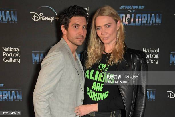 """Joseph Bates and Jodie Kidd attend a private view of """"The Mandalorian And The Child"""", a special portrait being unveiled in collaboration with the..."""