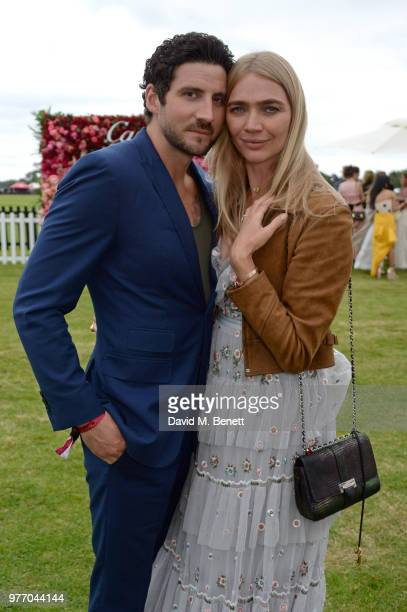 Joseph Bates and Jodie Kidd attend the Cartier Queen's Cup Polo Final at Guards Polo Club on June 17 2018 in Egham England