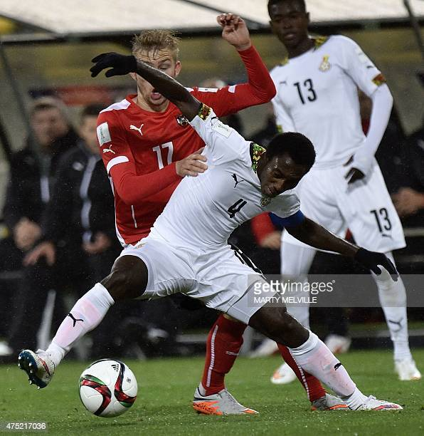 Joseph Bempah of Ghana is tackled by Konrad Laimer of Austria during their FIFA Under20 World Cup football match in Wellington on May 30 2015 AFP...