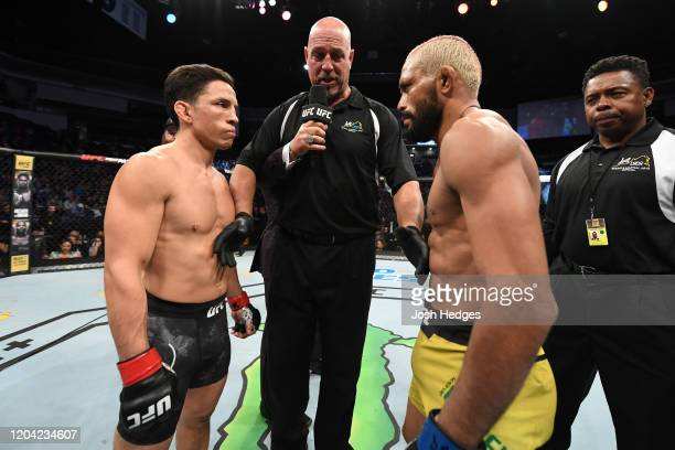 Joseph Benavidez and Deiveson Figueiredo face off prior to their flyweight championship bout during the UFC Fight Night event at Chartway Arena on...