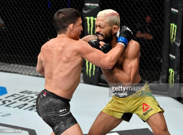 Joseph Benavidez and Deiveson Figueiredo of Brazil trade strikes in their UFC flyweight championship bout during the UFC Fight Night event inside...