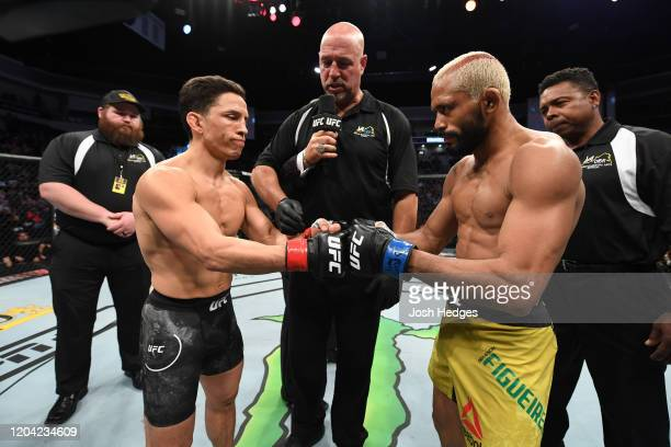 Joseph Benavidez and Deiveson Figueiredo touch gloves prior to their flyweight championship bout during the UFC Fight Night event at Chartway Arena...