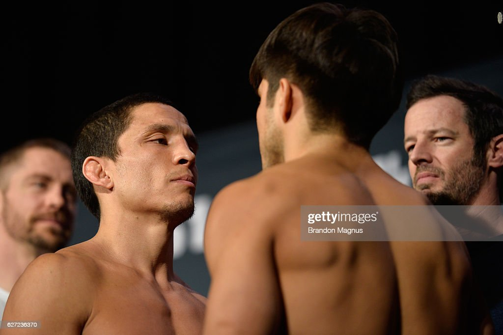 Joseph Benavidez and Henry Cejudo face off during the TUF Finale weigh-in in the Palms Resort & Casino on December 2, 2016 in Las Vegas, Nevada.