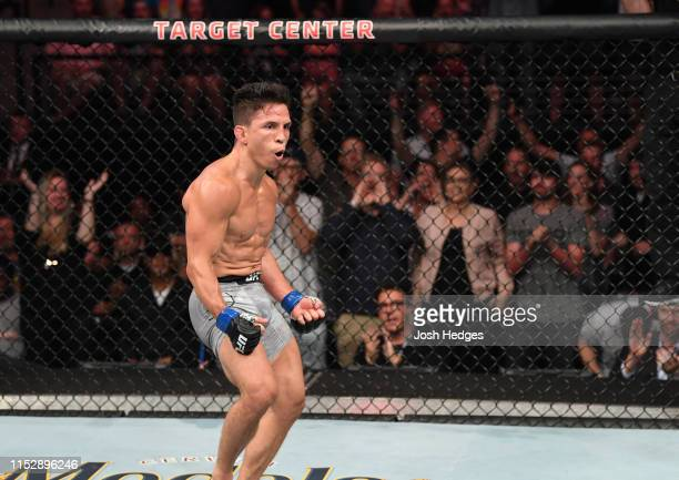 Joseph Benavidez celebrates after defeating Jussier Formiga of Brazil in their flyweight bout during the UFC Fight Night event at the Target Center...