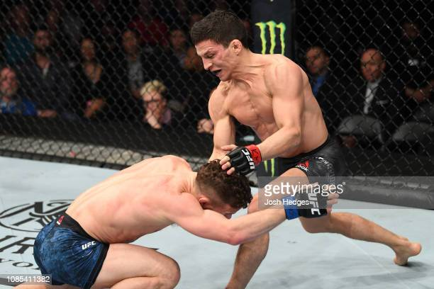 Joseph Benavidez defends a takedown attempt from Dustin Ortiz in their flyweight bout during the UFC Fight Night event at the Barclays Center on...