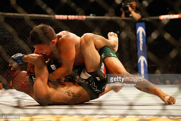 Joseph Benavidez elbows John Moraga in their flyweight bout during the UFC 187 event at the MGM Grand Garden Arena on May 23, 2015 in Las Vegas,...