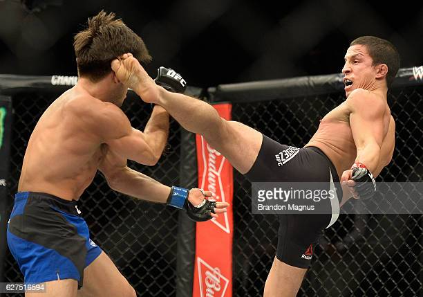 Joseph Benavidez kicks Henry Cejudo in their flyweight bout during The Ultimate Fighter Finale event inside the Pearl concert theater at the Palms...