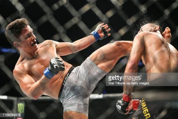 Joseph Benavidez lands a high kick on Jussier Formiga. Benavidez would go on to win by TKO.