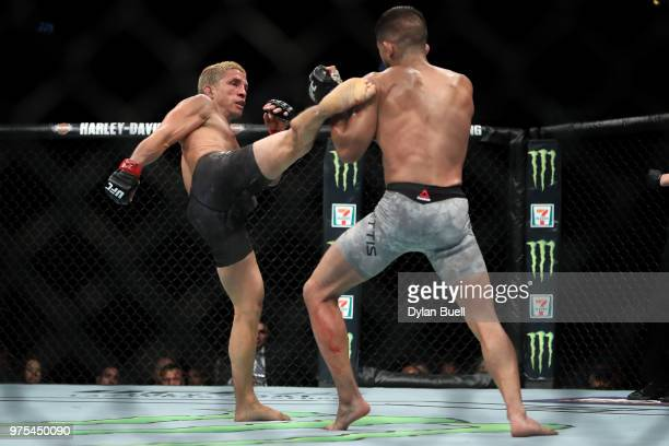 Joseph Benavidez lands a kick against Sergio Pettis in the third round in their flyweight bout during the UFC 225 Whittaker v Romero 2 event at the...