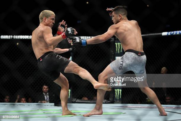 Joseph Benavidez lands a kick on Sergio Pettis in the second round in their flyweight bout during the UFC 225 Whittaker v Romero 2 event at the...