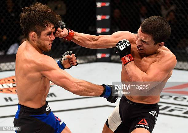 Joseph Benavidez punches Henry Cejudo in their flyweight bout during The Ultimate Fighter Finale event inside the Pearl concert theater at the Palms...