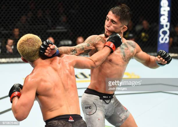 Joseph Benavidez punches Sergio Pettis in their flyweight fight during the UFC 225 event at the United Center on June 9, 2018 in Chicago, Illinois.