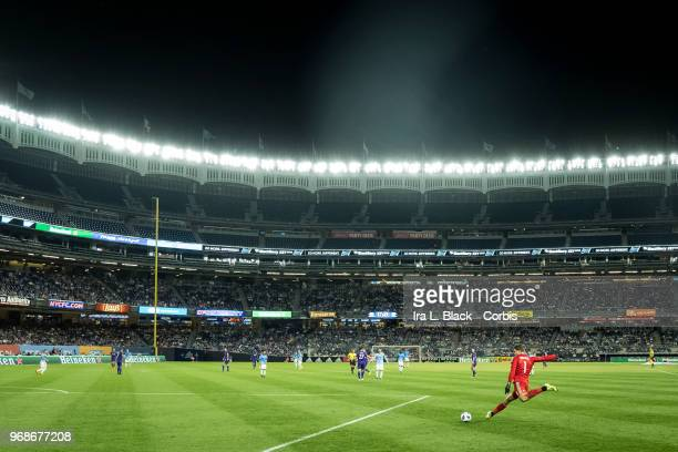 Joseph Bendik of Orlando City takes a kick to clear the ball during the MLS Pride Night between New York City FC and Orlando City SC at Yankee...