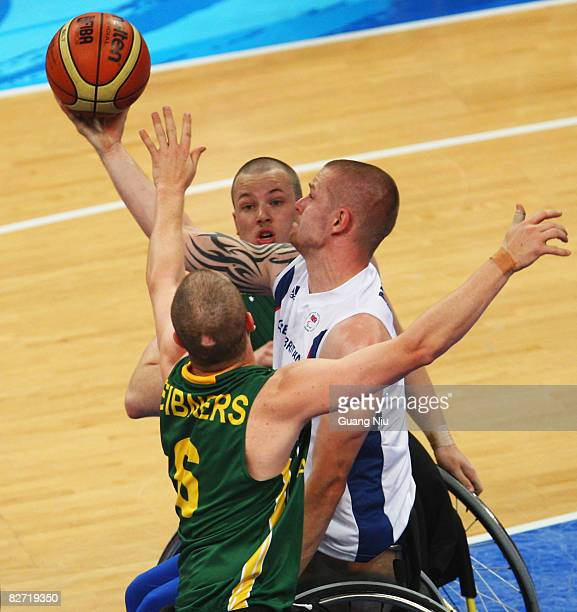 Joseph Bestwick of Great Britain tries to shoot a ball from Brett Stibners and Shaun Norris of Australia in the Wheelchair Basketball match between...