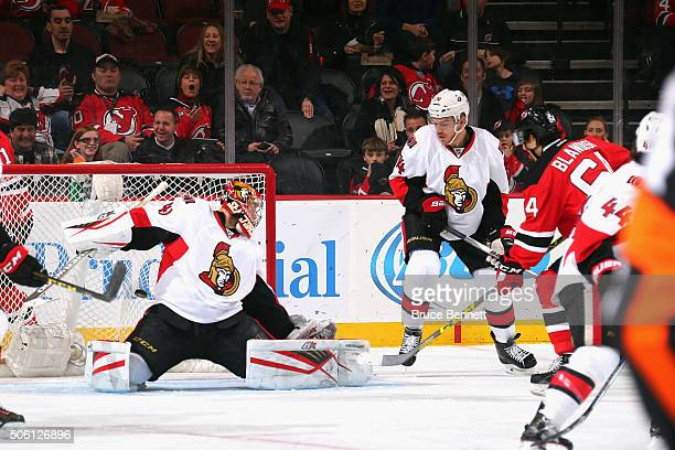Joseph Blandisi of the New Jersey Devils scores his first NHL goal against Craig Anderson of the Ottawa Senators during the first period at the...