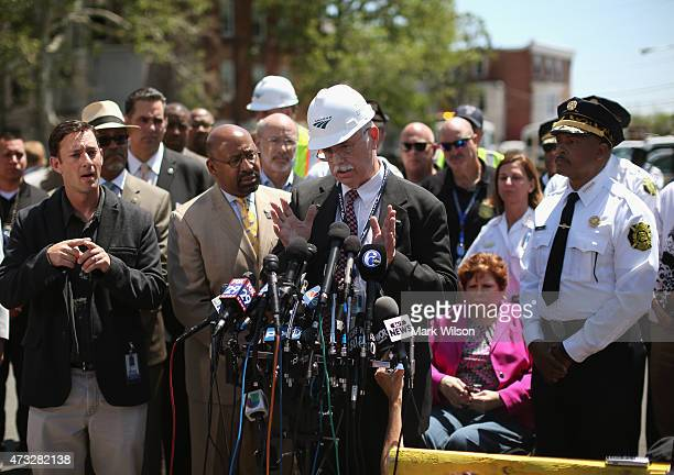 Joseph Boardman President and CEO of Amtrak speaks to the media about the Amtrak train derailment while flanked by Philadelphia Mayor Michael Nutter...