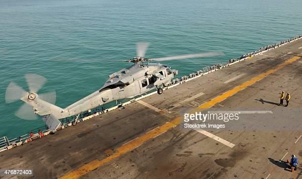 Joseph Bonaparte Gulf, September 7, 2013 - An MH-60S Sea Hawk helicopter lands on the flight deck of the forward-deployed amphibious assault ship USS Bonhomme Richard.