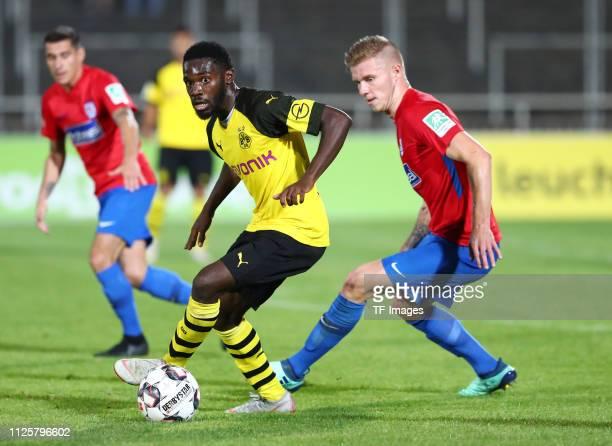 Joseph Boyamba of Borussia Dortmund II and Angelo Langer of Wuppertaler SV battle for the ball during the Regionalliga West match between Borussia...