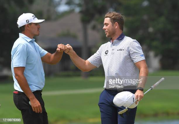 Joseph Bramlett and Luke List bump elbows on the 18th green after List won the final round at the Korn Ferry Tour's Korn Ferry Challenge at TPC...
