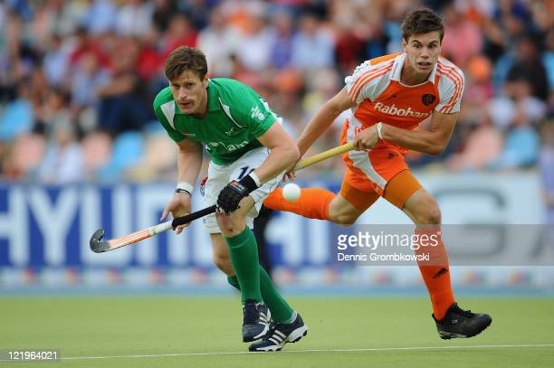 Joseph Brennan of Ireland challenges Sander de Wijn of Netherlands during the Men´s EuroHockey Championships 2011 Pool B match between Netherlands...