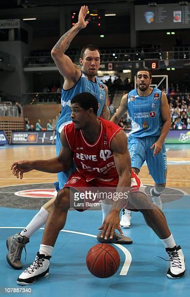 Joseph Buck of Duesseldorf challenges Kyle Hines of Brose during the Beko Basketball Bundesliga match between Gloria Giants Duesseldorf and Brose...
