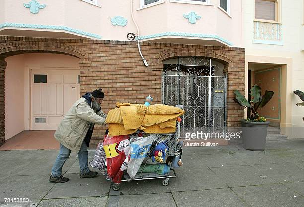 Joseph Cappa a homeless person pushes his shopping cart through a residential neighborhood February 28 2007 in San Francisco California According to...