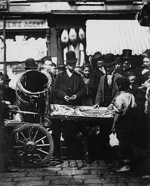 Joseph Carney at his fish stall in the market between...