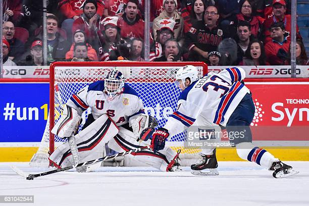 Joseph Cecconi of Team United States reaches for the puck in front of goaltender Tyler Parsons during the 2017 IIHF World Junior Championship gold...
