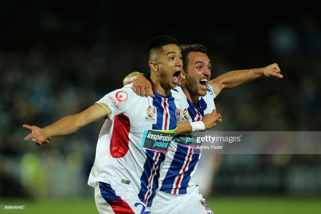 Joseph Champness and Benjamin Kantarovski of the Jets celebrate a goal by Joseph Champness during the round one A-League match between the Central Coast Mariners and the Newcastle Jets at Central Coast Stadium on October 7, 2017 in Gosford, Australia.