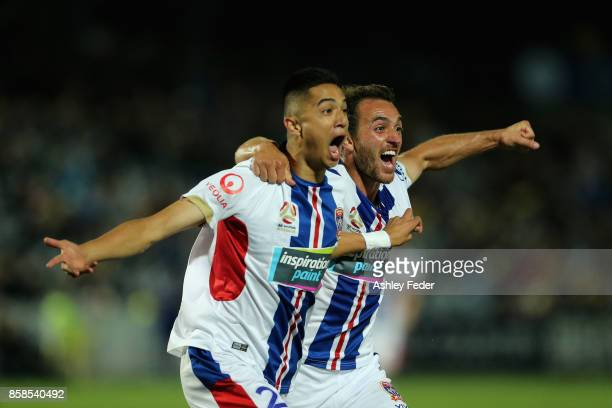 Joseph Champness and Benjamin Kantarovski of the Jets celebrate a goal by Joseph Champness during the round one ALeague match between the Central...