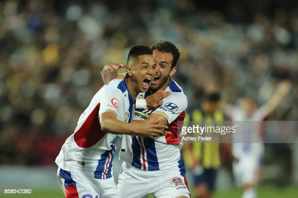 Joseph Champness and Benjamin Kantarovski of the Jets celebrate a goal by Joseph Champness during the round one A-League match between the Central...